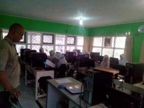Mr. Rian(tutor) tutoring the students