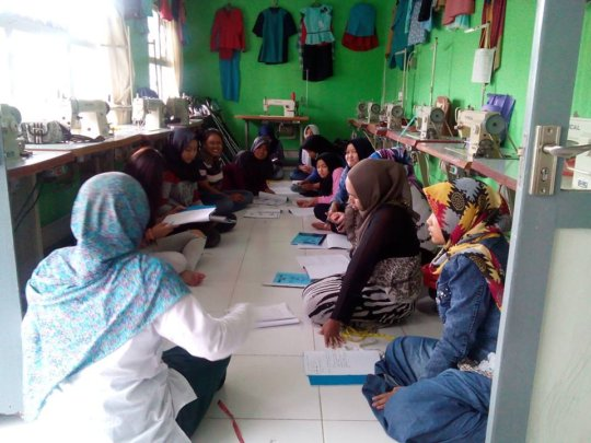 Sewing class students with Miss Ila