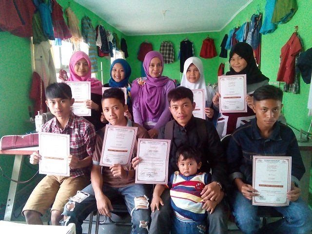 The sewing class students receiving certificates