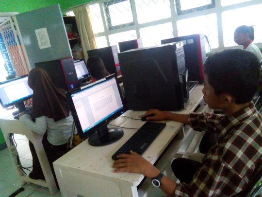 The students practicing typing