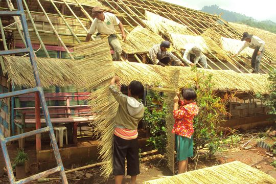 The girls helping to fix their home