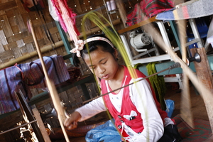 Boarding house girl helping at the weaving centre