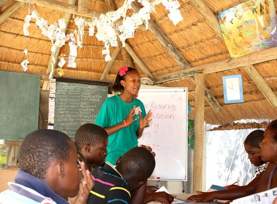 Eco Club member, Ashandy, teaches the kids