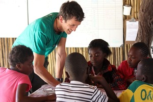 Arnaud, volunteer, teaching the children