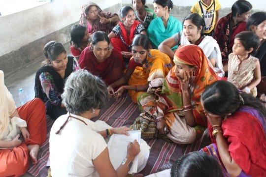 Urmi meeting with women