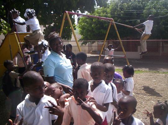 pre-school teacher patrolling the playground
