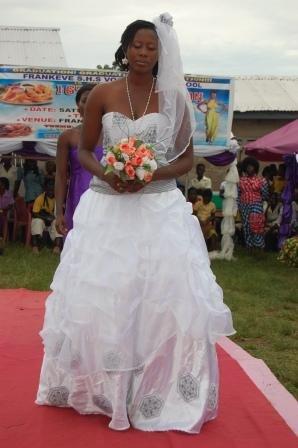 wedding dress showcased by a graduand