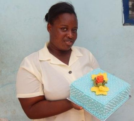 Vivian hold one of her cake designs after class