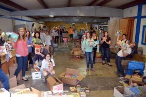 Nobelity Project volunteer team sorting books