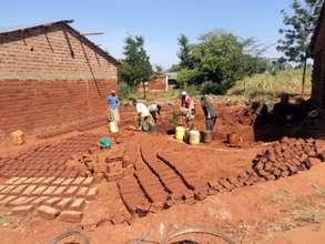Mutaki Primary Parents Making Bricks