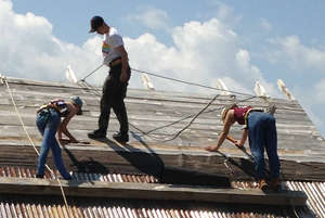 International volunteers building the walipini