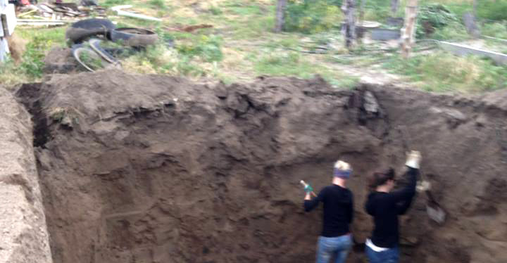 International volunteers digging out the walapini