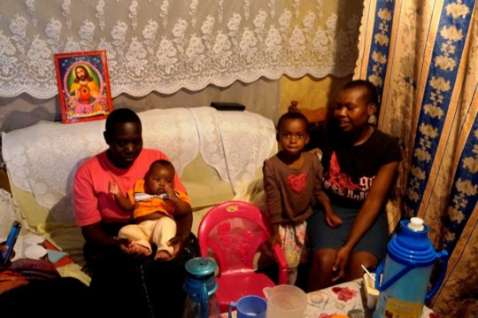 Bentado sits with Pauline & Ismael in their home.