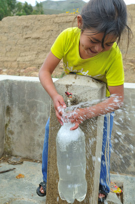 Girl demonstrating how to treat drinking water