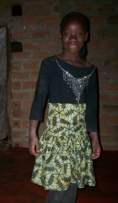 Matilda's daughter, happy in her home-made Dress