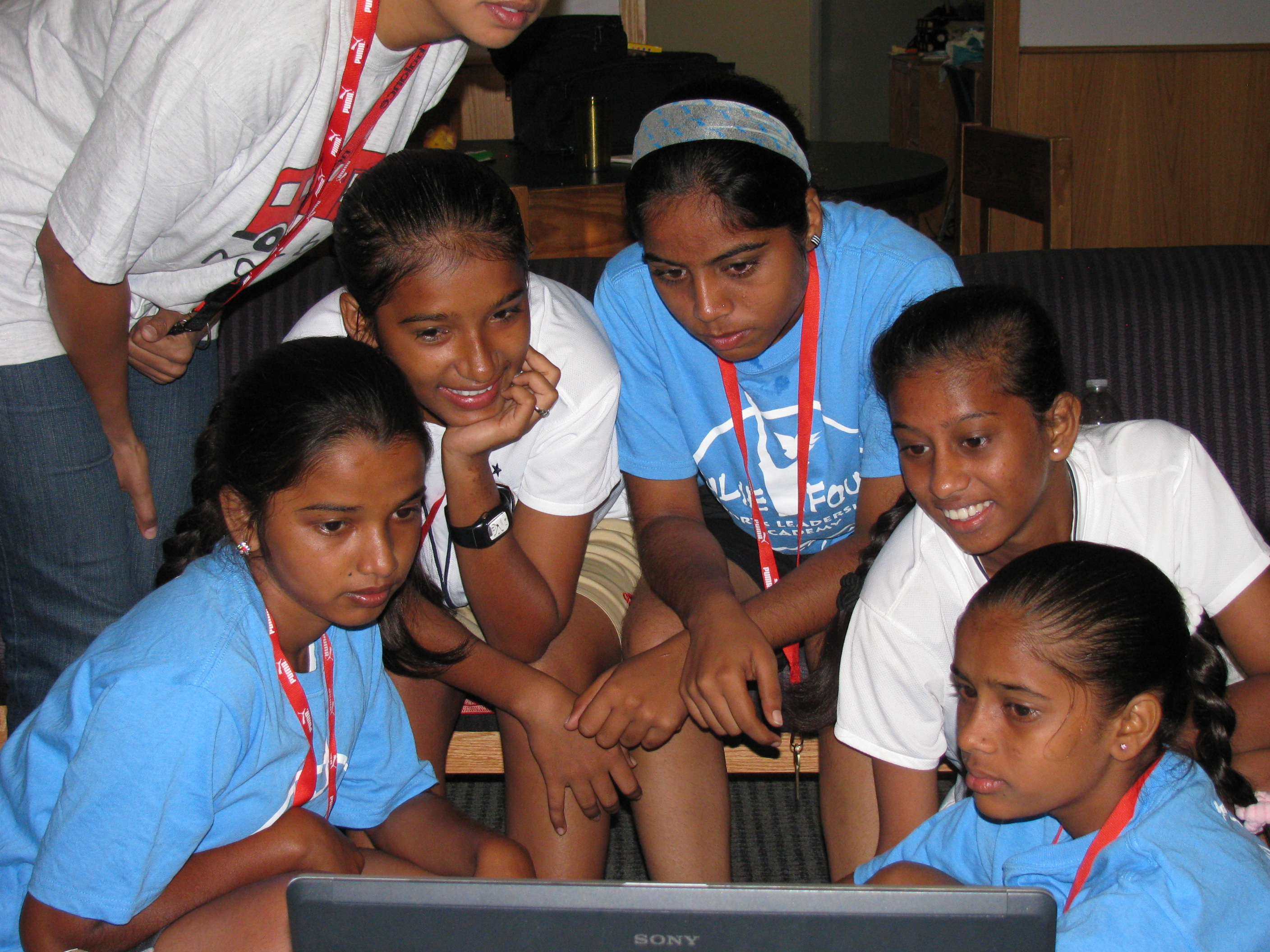 Huddled around the laptop in New Jersey, the girls from India in the midst of an emotional video chat with their parents back in Mumbai...