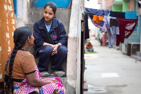 Gulafsha speaks to elders in the community