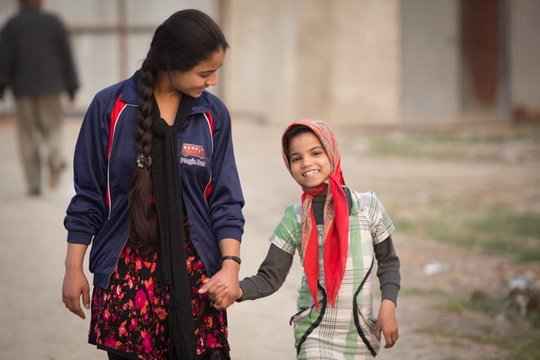 Gulafsha serves as a role model to a young girl