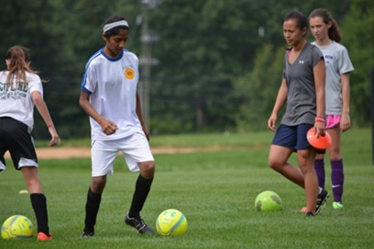 Nikhitha with Coach Ali working on her foot skills