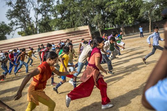 Create 4000 high school graduates in India