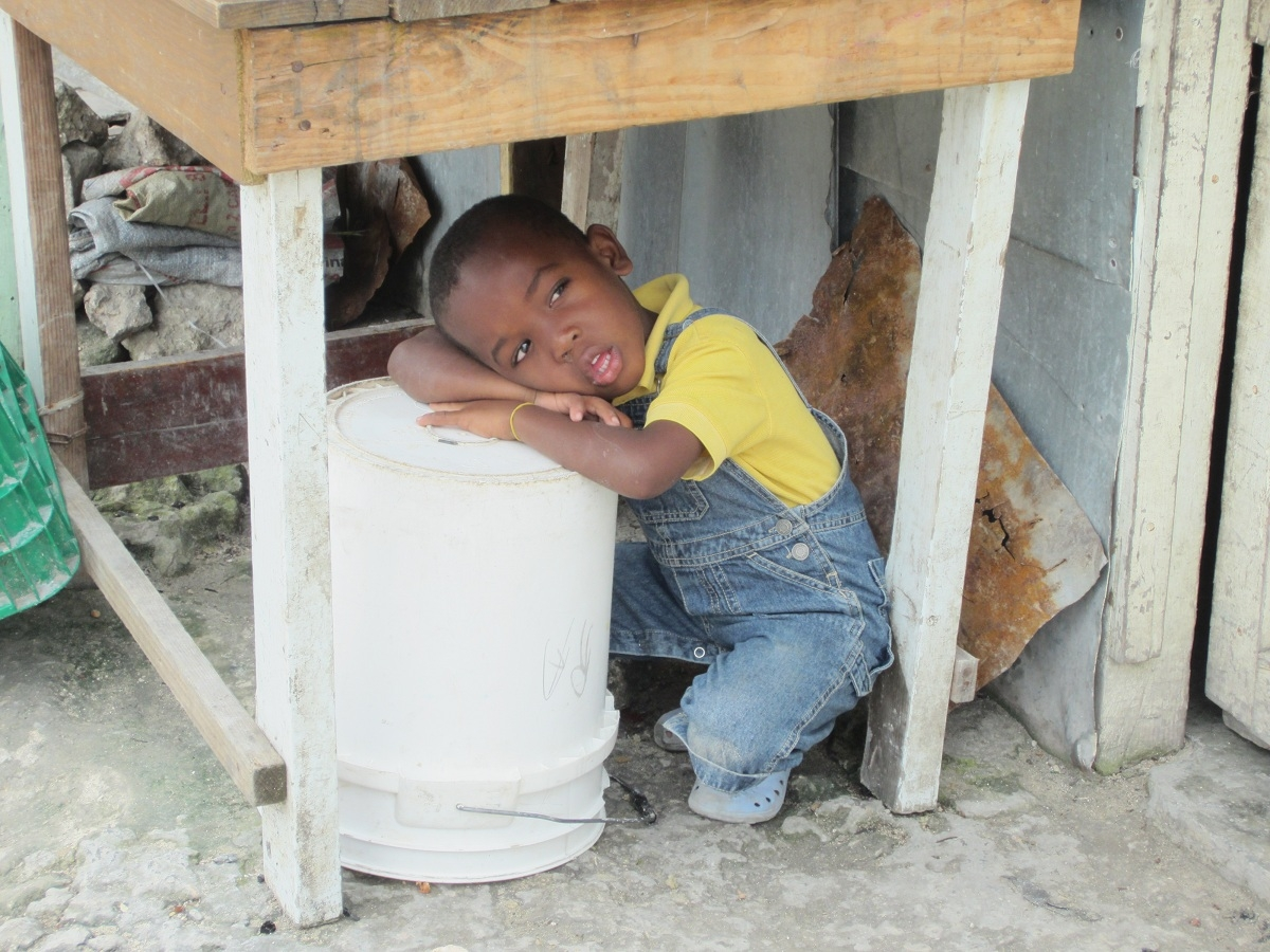 This little boy is a resident of the town of Veron, outside of the tourist region of Punta Cana, Dominican Republic. He was spending time with some other little friends on the streets one morning when we snapped this photo of him. Our project will build a new school to benefit young children.