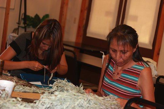 Tamara and Katie preparing the Sage for braids