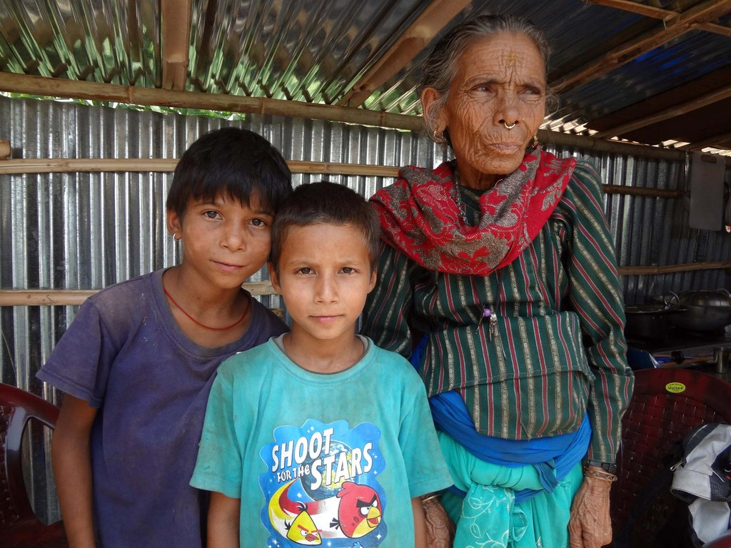 Two boys and grandmother made homeless by quake