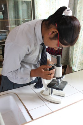 Nepali girl in training to be a lab technician
