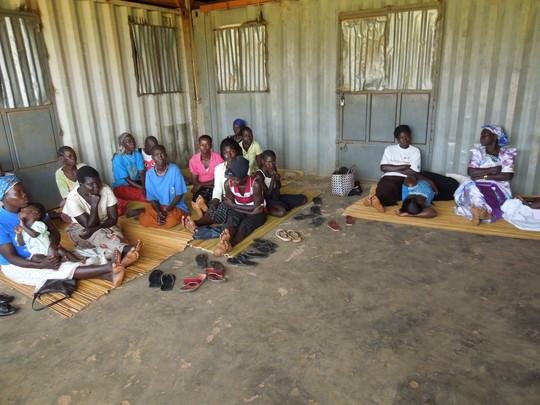 The women at their biweekly microfinancing meeting
