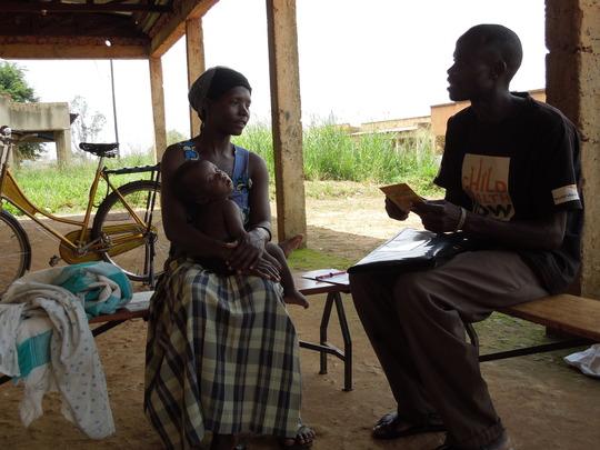 Mother speaking to a village health team worker