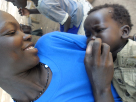 Baby Lajul receiving deworming tablets
