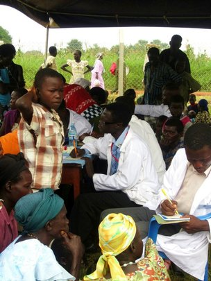 medical health workers attending to people