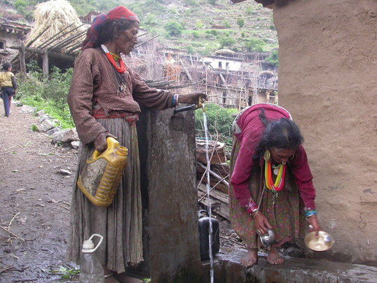 Women using DWS to collect water