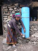 Woman collecting water from filter system