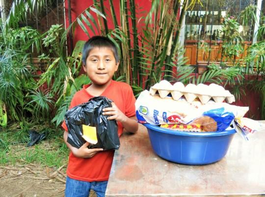 Pedro receiving his Christmas gift and basket