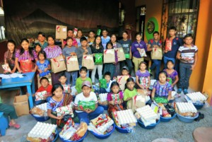 All of our sponsored students with their gifts!