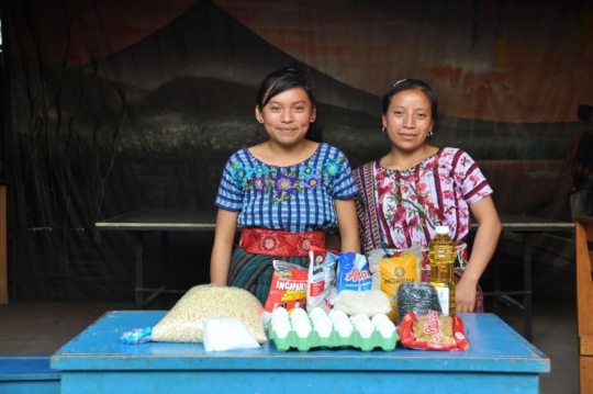 Concepcion and her mother receive a food basket