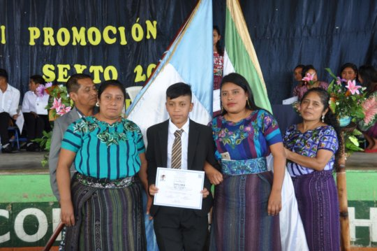 Sponsored student Diego with his mother and sister