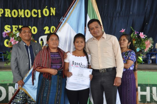 Sponsored student Heidy with her parents
