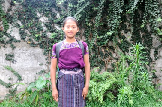 Fourth-grader Dorcas with her school backpack