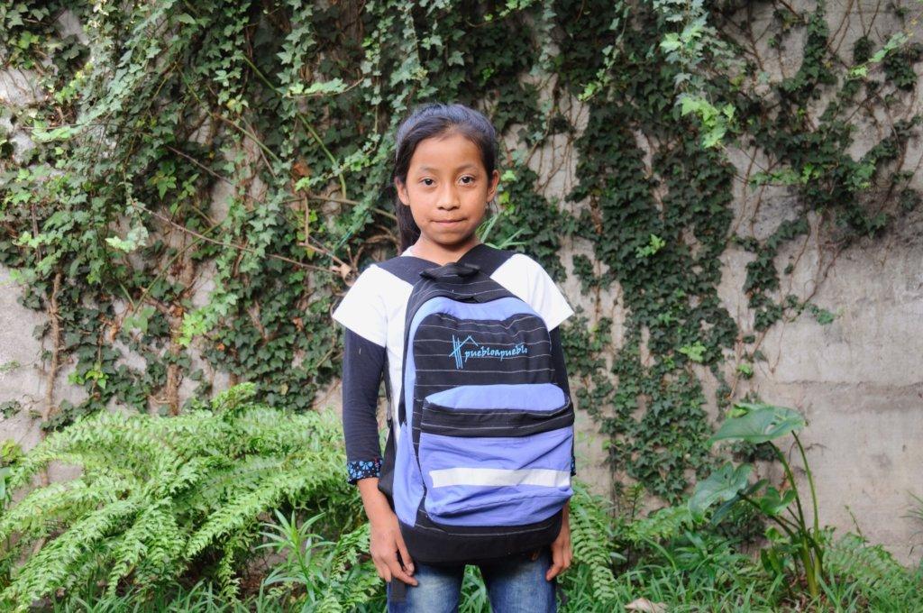 Elena with her school backpack