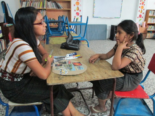 Isabela and Maria Isabel in a tutoring session