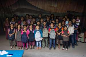 Sponsored students with their new backpacks