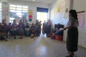 Johanny speaking at a workshop