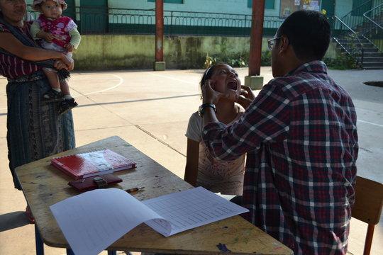 Students in Chacaya receiving school supplies