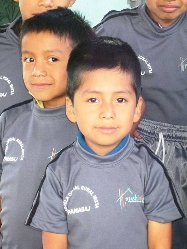 A student in Panabaj wears his new uniform