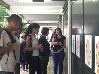 The director talking with students