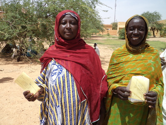 Women receive their food vouchers