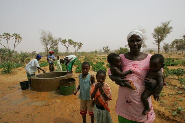 Women and children gather around community well