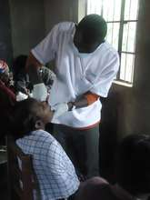 David giving exam to patient